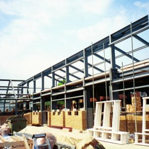 an image of the large steel frames of a warehouse