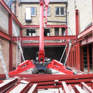 an image of a range of steel frames about to be erected into place
