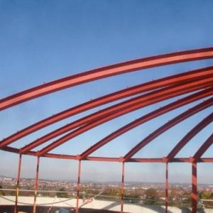 an image of the skeleton of a structural steel arched roof