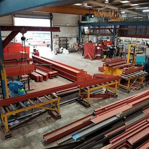 an image of the Mundy Structural Steel workshop from a mid-level angle, which shows the large retracting door and more red, structural steel
