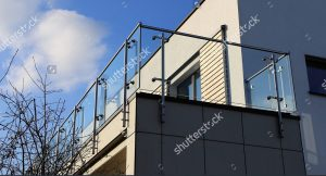 an image of a modern balcony with steel and glass railings