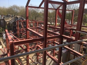 an image of the red structural steel beams that make up the base of a building structure