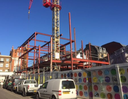 an image of a commercial residential construction project, erecting a building for flats