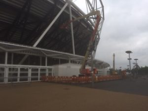 an image of a Mundy Structural Steel crane working on the outside of West Ham's new stadium in London