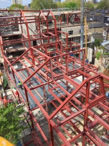 an image of the structural steel framework for an apartment building in London