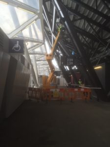 an image of a piece of machinery lifting steel beams into place outside the disabled toilers in a section of the new West Ham Stadium