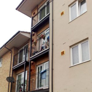 an image of three traditional steel balconies on a block of flats