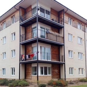 an image of three modern, steel balconies on a block of apartments