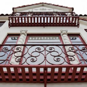 an image of two steel balconies with intricate railing pattens