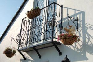 an image of a steel balcony with steel hanging baskets