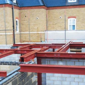 an image of the structural supports on the first floor of a building being constructed