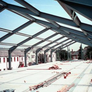 an image of the steel roof structure of a warehouse