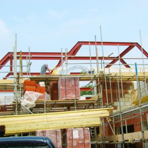 an image of the roof structure of a building being made using steel