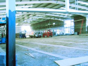 an image of a large warehouse being renovated with steel