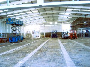 an image of the inside of a warehouse made using structural steel