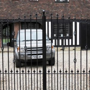 an image of a Land Rover behind steel gates