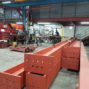 an image some of the red structural steel fabricated by Mundy Structural Steel, from eye-level point of view