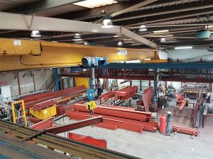 an image of the Mundy Structural Steel workshop from an elevated angle, which shows the manufactured structured steel produced by the company within a warehouse-like building