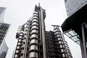 an image of the steel facade of the Lloyd's Building in London
