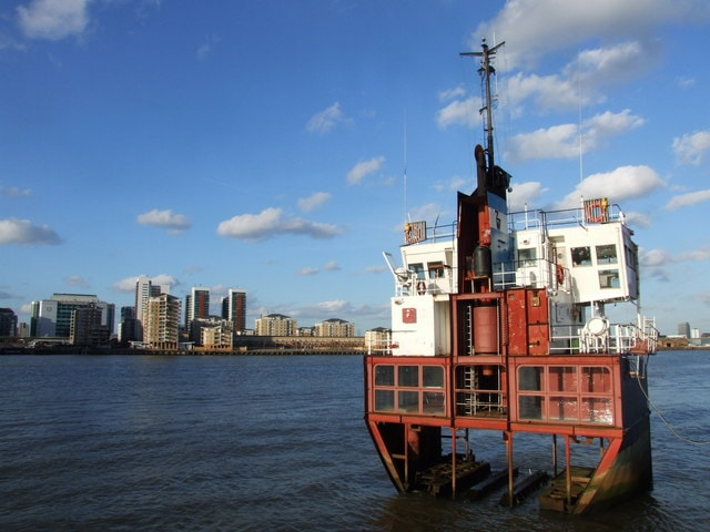 an image of A Slice of Reality, a steel sculpture in the River Thames
